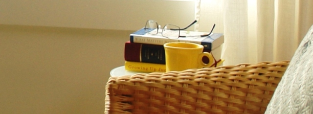 Closeup of the counselling office in Victoria, highlighting the psychotherapy books on the table.